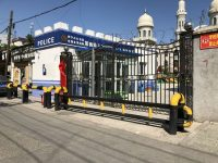A police station next door to a mosque in Yining, China, on Aug. 21. (Anna Fifield/TWP)