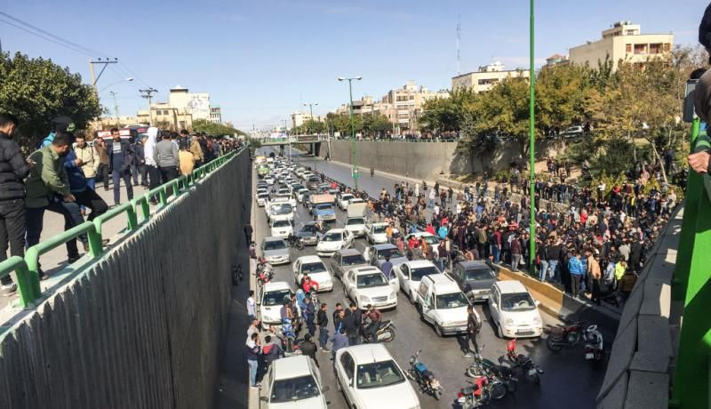 Iranian protesters block a road during a demonstration against an increase in gasoline prices in Isfahan on 16 November. Photo: Getty Images.