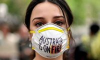 A demonstrator with a mask attends a climate rally in Sydney last Wednesday as bushfire smoke choked the city and the Australian government used the COP25 Madrid climate talks in Spain to push for dodgy accounting tricks to halve its climate effort. Photograph: Saeed Khan/AFP via Getty Images