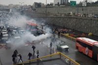 People protesting on a highway against increased gas prices in Tehran in November.Credit...Wana News Agency, via Reuters