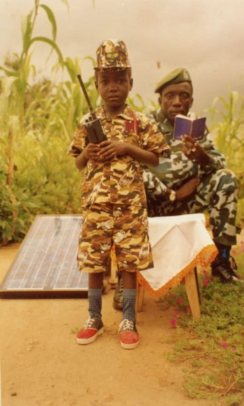 "Charles Tabuley, the late commander of the Lord's Resistance Army, pictured around 2003 with a girl in a military uniform from his ""family."" (Charles Tabuley/Acholi Religious Leaders Peace Initiative)"