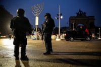 Police officers at Grand Army Plaza in Brooklyn before a vigil for the victims of an assault at a rabbi's house in Monsey, N.Y.Credit...Amr Alfiky/Reuters