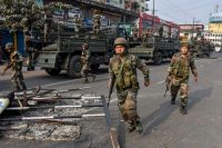 Soldiers patrol during curfew Dec. 12 in Guwahati, India, following protests over the Indian government's passage of the Citizenship Amendment Bill. (AFP/Getty Images)