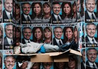 2019 Getty Images A homeless man sleeping under posters of newly elected President Alberto Fernández and his running mate, Vice-President Cristina Fernández de Kirchner, Buenos Aires, October 28, 2019