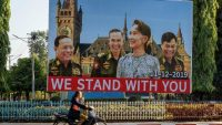A billboard depicting Myanmar State Counsellor Aung San Su Kyi with the three military ministers in front of a background showing the building of the International Court of Justice in The Hague is displayed along a main road in Hpa-an, Karen State. AFP