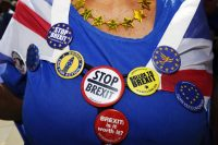 A protester wears anti-Brexit badges. (Luke MacGregor/Bloomberg News)