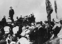 Grigory Zinoviev addressing workers at the Baku oil fields in 1919.Credit...Hulton Archive/Getty Images
