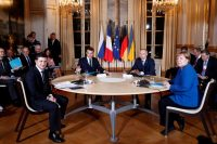 President Volodymyr Zelensky of Ukraine, left, joined Presidents Emmanuel Macron of France and Vladimir Putin of Russia, and Chancellor Angela Merkel of Germany in talks on the conflict in Ukraine on Monday in Paris.Credit...Pool photo by Ian Langsdon