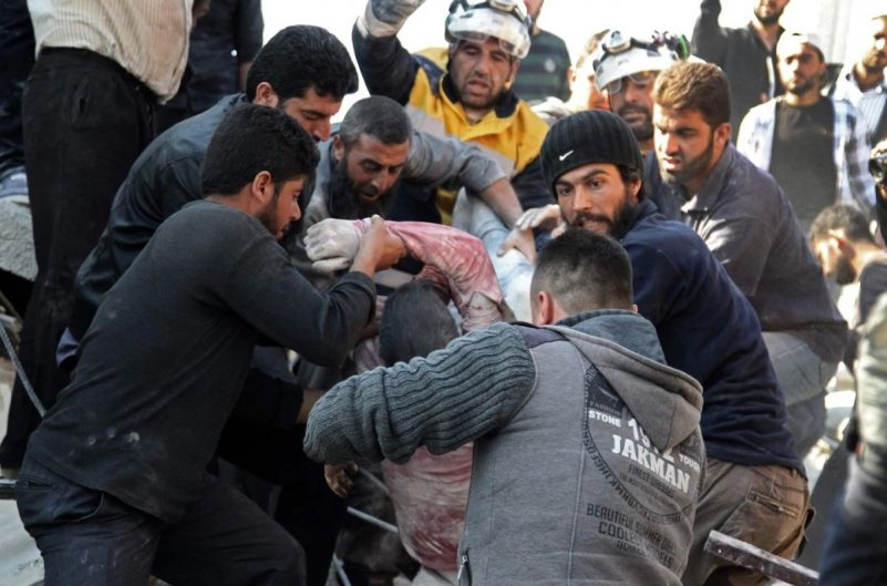 Members of the Syrian Civil Defense, also known as the White Helmets, and residents pull a wounded youth from the rubble of a building after a reported airstrike by pro-government forces on the village of Shinan in the northwestern Idlib province on Nov. 12. (Abdulaziz Ketaz/AFP/Getty Images)