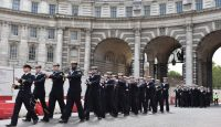 Crew members from HMS Westminster march through Admiralty Arch as they exercise their freedom of the city in August 2019 in London. Photo: Getty Images.