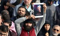 'Suleimani may have, with his death, already have achieved the greatest revenge of all.' A man holds a picture of Suleimani during a demonstration in Tehran on Friday. Photograph: Atta Kenare/AFP via Getty Images