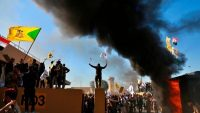 Protesters burn property Tuesday in front of the U.S. Embassy in Baghdad. (Khalid Mohammed/AP)