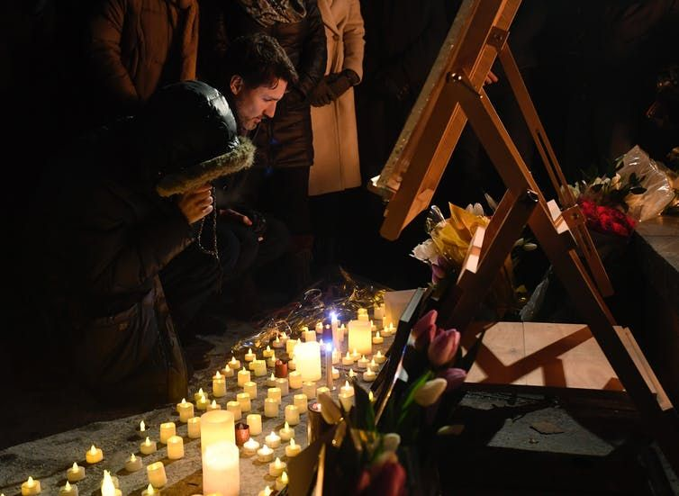 Prime Minister Justin Trudeau attends a candlelight vigil for victims of the Ukraine International Airlines crash in Tehran, in Ottawa, on Jan. 9, 2020. THE CANADIAN PRESS/Adrian Wyld