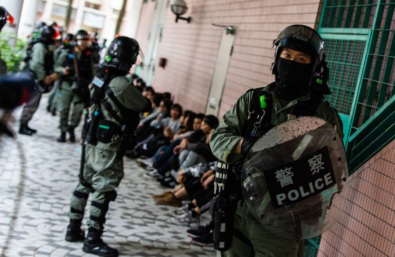Willie Siau/SOPA Images/LightRocket via Getty Images Police in riot gear rounding up suspected protesters, Hong Kong, January 5, 2020