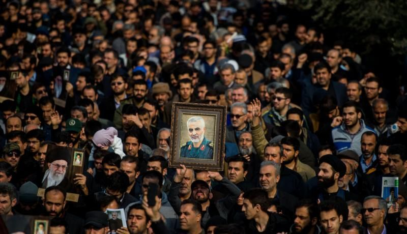 Protesters hold up an image of Qassem Soleimani during a demonstration in Tehran on 3 January. Photo: Getty Images.