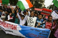 University students protest India's new citizenship law, in Kolkata, India, on Monday. (AP) (Bikas Das/AP)