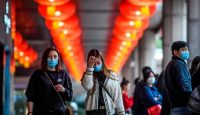 Pedestrians wear face masks as they walk in Macau on 22 January, after the region reported its first case of the new coronavirus that originated in Wuhan, China. Photo: Getty Images.