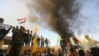 Members of Iraq's pro-Iranian al-Hashd al-Shaabi group and protesters set ablaze a sentry box outside the U.S. Embassy in Baghdad on 31 December 2019. AHmad al-Rubaye/Agence France Presse