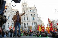 Santiago Abascal, leader of the Vox party, waves at a rally in Madrid on Jan. 12 protesting the new coalition government of Spanish Prime Minister Pedro Sánchez. (Jon Nazca/Reuters)