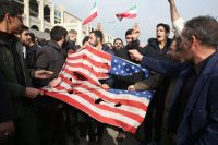 Iranians tearing up a United States flag during a demonstration in Tehran on Friday after the killing of General Suleimani.Credit...Atta Kenare/Agence France-Presse — Getty Images