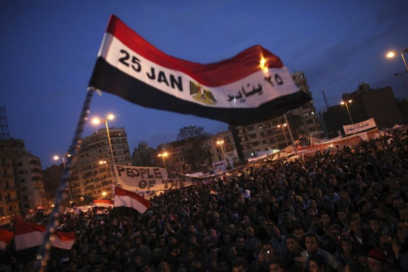 A flag is waved by anti-government protesters as they demonstrate in Tahrir Square in Cairo on Feb. 10, 2011. (Tara Todras-Whitehill/AP)
