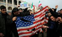 'Donald Trump has consistently increased tensions and courted confrontation with Iran.' Iranians burn a US flag in Tehran on Friday. Photograph: Abedin Taherkenareh/EPA