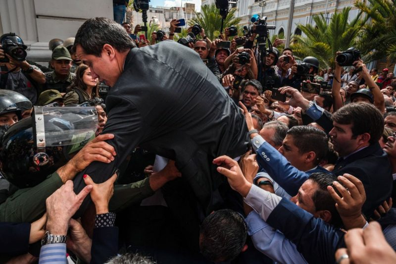 Juan Guaidó tried to jump a fence in a failed effort to enter the National Assembly on Jan. 7. Credit Adriana Loureiro Fernandez for The New York Times