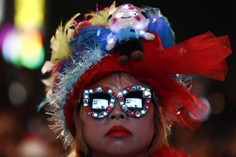 A supporter of Han Kuo-yu, a candidate for president, watching election returns on Saturday. Mr. Han, who favors close ties to China, lost his bid to unseat the incumbent, Tsai Ing-wen. Credit Ritchie B Tongo/EPA, via Shutterstock