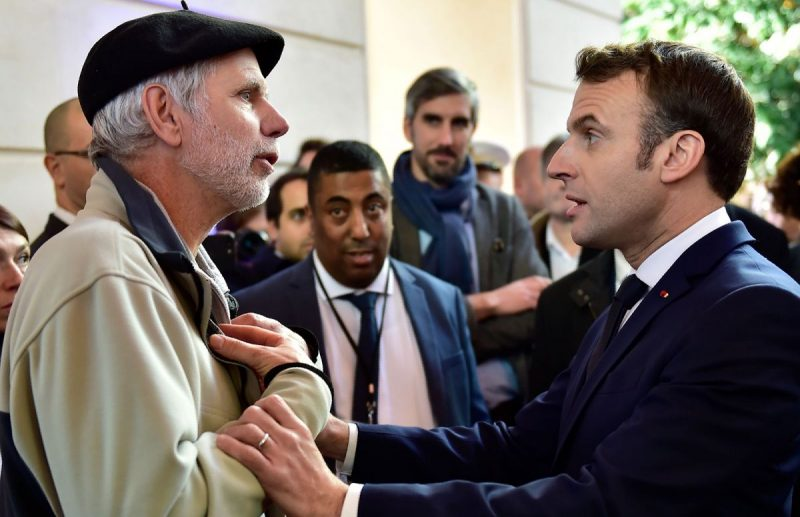 Georges Gobet/Pool/AFP via Getty Images A math teacher, Pierre Coste, arguing with French President Emmanuel Macron about the government's pension reforms, Pau, southwest France, January 14, 2020