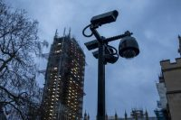 Security cameras on a pole near Parliament in London on Jan. 6. (Jason Alden/Bloomberg)