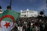 Thousands of Algerians take to the street to commemorate the first anniversary of the popular protests in Algiers on Friday. (Toufik Doudou)