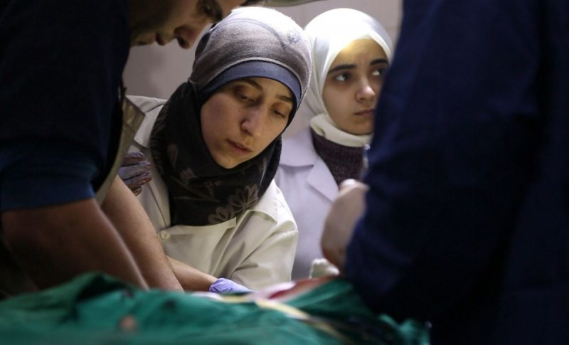 National Geographic Dr. Amani Ballour, working in an underground hospital operating room in Eastern Ghouta, Syria, in a scene from the documentary The Cave