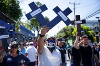Supporters of Salvadoran President Nayib Bukele protest to demand a loan for public safety. (Rodrigo Sura/EPA-EFE/REX/Shutterstock)