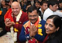 Aam Aadmi Party chief and Chief Minister of Delhi Arvind Kejriwal, center, his wife Sunita Kejriwal, right, and Deputy Chief Minister of Delhi Manish Sisodia visit Hanuman Mandir in New Delhi on Tuesday. (Str/EPA-EFE/REX/Shutterstock)