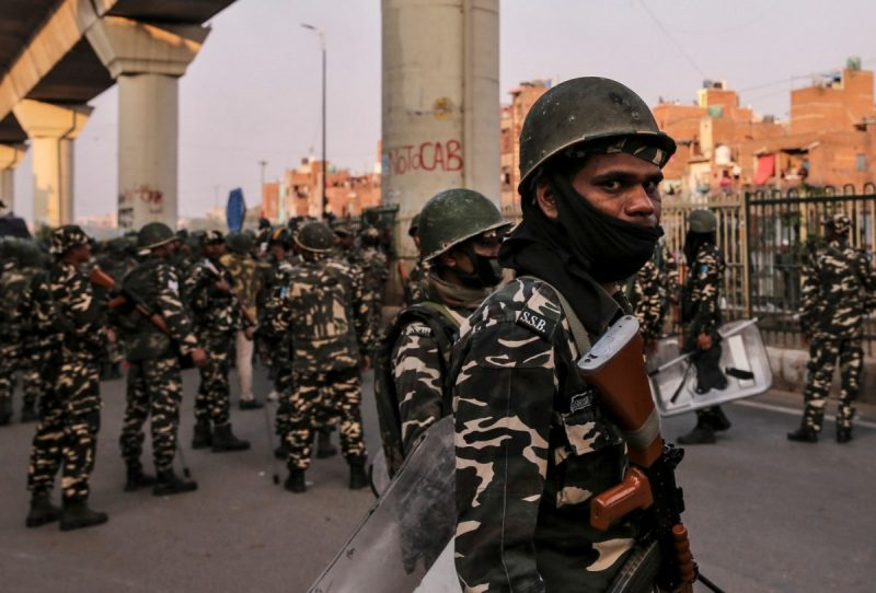 Paramilitary troops patrol in New Delhi on Tuesday after clashes erupted between people demonstrating for and against a new citizenship law. (Danish Siddiqui/Reuters)