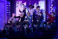 Lil Nas X, top center, performs with the K-pop group BTS at the Grammy Awards in Los Angeles in January. (Kevork Djansezian/AFP/Getty Images)