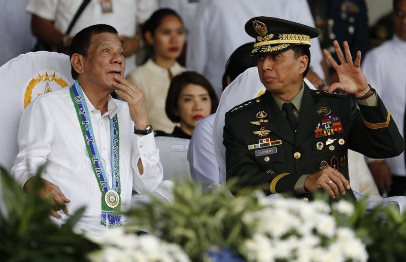 Duterte (left) with the Philippines' armed forces chief of staff, Lieutenant General Noel Clement. Rolex Dela Pena/EPA