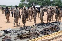 Military commanders inspect arms and ammunitions recovered from Boko Haram jihadists. Audu Marte/AFP via Getty Images