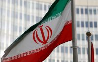 The Iranian flag in front of the International Atomic Energy Agency headquarters in Vienna.Credit...Leonhard Foeger/Reuters