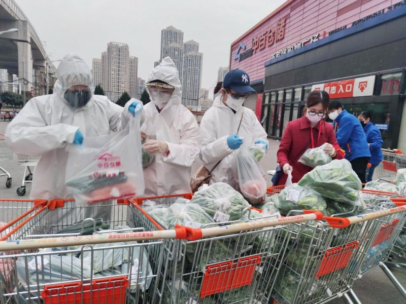 Community workers and volunteers in Wuhan, China, packing groceries purchased through group orders after supermarkets stopped sales to individuals in the midst of the epidemic. Credit China Daily/Reuters