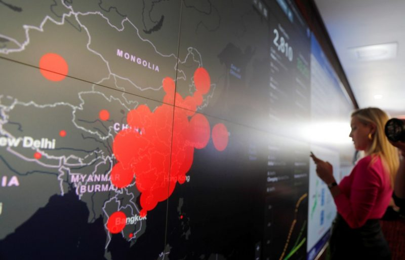 A global map at the Department of Health and Human Services showing where the known outbreaks of the coronavirus have occurred. Credit Carlos Barria/Reuters