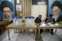 Poll workers during parliamentary elections in Tehran on Friday.Credit...Wana/Reuters