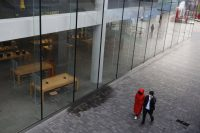 People walked past a closed Apple store in Beijing, China, earlier this month.Credit...Wu Hong/EPA, via Shutterstock