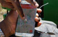 A mobile phone in Umande village in Nanyuki, Kenya. (Njeri Mwangi/Reuters)