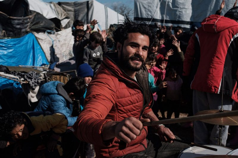 Nick Paleologos/SOOC An asylum-seeker playing on a makeshift drum kit to entertain children in Vial refugee camp, Chios, Greece, February 8, 2020