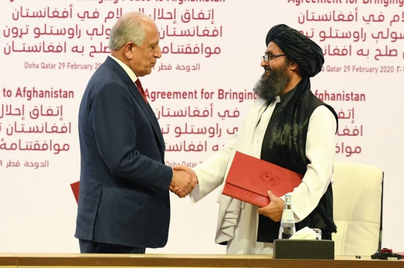 Zalmay Khalilzad, left, an American negotiator, with Mullah Abdul Ghani Baradar, deputy leader of the Taliban, during the signing ceremony of the U.S.-Taliban peace agreement on Saturday. Credit EPA, via Shutterstock
