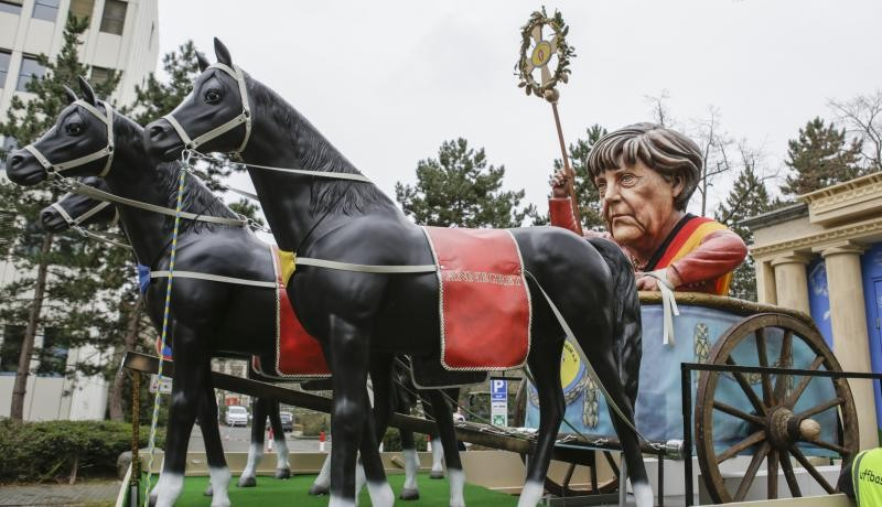 German Chancellor Angela Merkel is depicted on a float in the Rosenmontag parade in Mainz on 24 February. Photo: Getty Images.