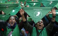 Activists with green handkerchiefs, symbolizing the abortion rights movement, demonstrate at the National Congress in Buenos Aires last year to mark the revival of their campaign to legalize abortion. (Emiliano Lasalvia/Afp Via Getty Images)