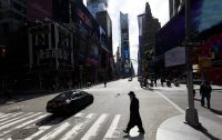 A person walks through a quiet Times Square in New York on Monday. (Justin Lane/EPA-EFE/REX/Shutterstock)