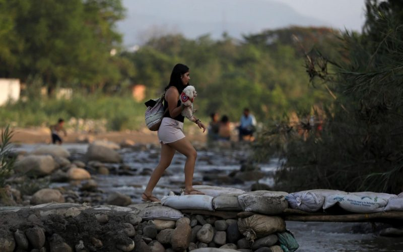 A woman crosses illegally into Colombia from Venezuela on May 1, 2019. (Fernando Vergara/AP)